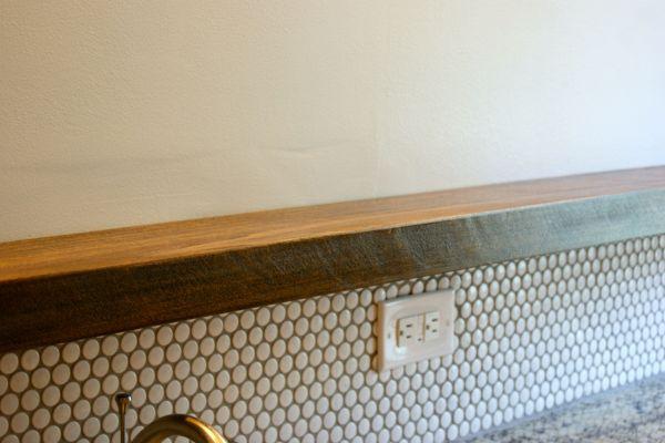 DIY floating bathroom shelf above vanity below mirror
