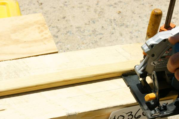 use scrap wood as a guide for cutting a straight line with a circular saw