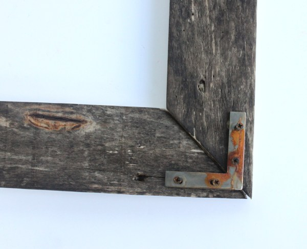 Industrial Picture Frame Tutorial by The Winthrop Chronicles featured by Remodelaholic