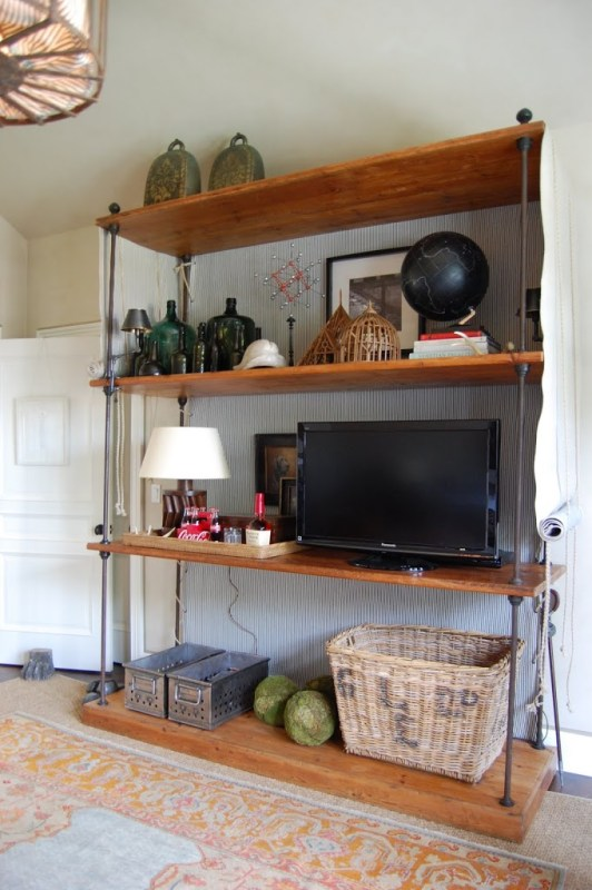 disguise a TV in a large shelving unit (Habitually Rustic)