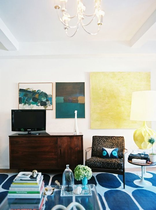 hang large art around the TV (via Apartment Therapy)