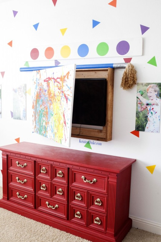 hide television behind kids artwork in a playroom (Kristen Duke Photography)
