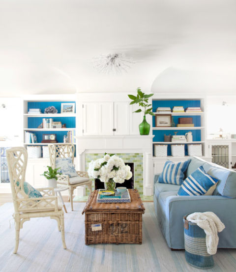 tuck away the television in a nook above the mantel (Country Living)