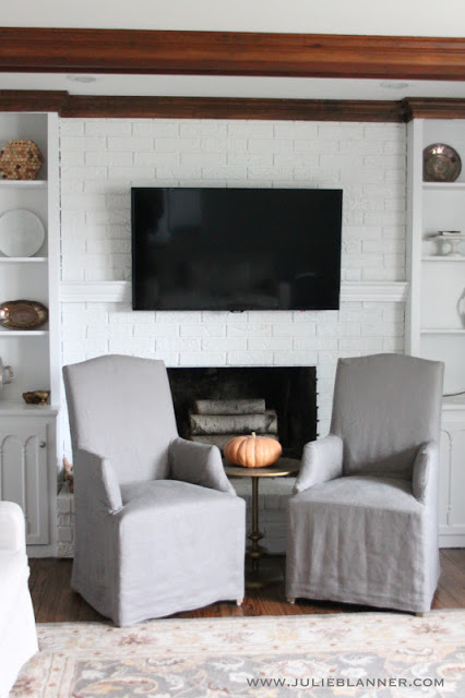 use hollow floating shelves for a mantel to hide television cords (Julie Blanner)