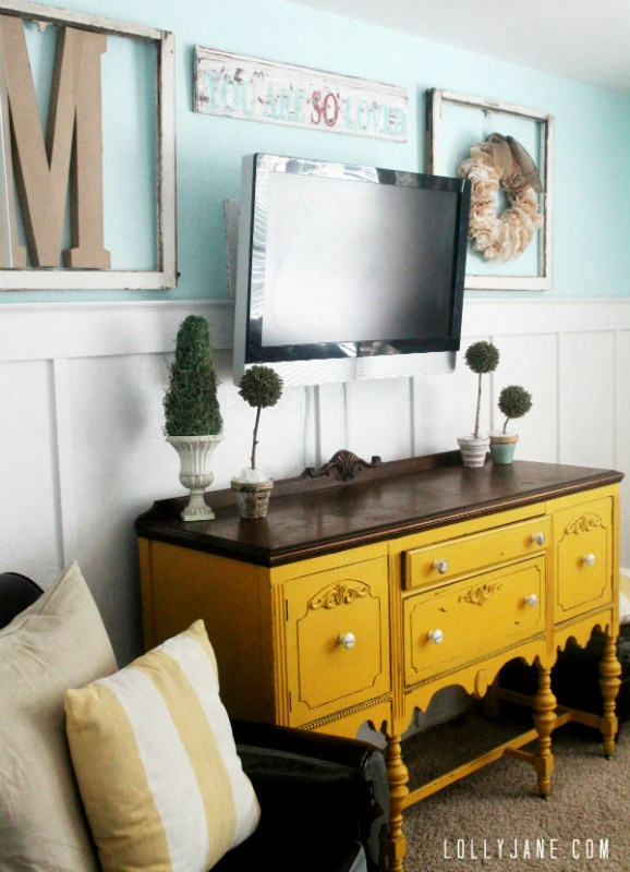 wall mounted tv with board and batten wainscoting and art (Lolly Jane)