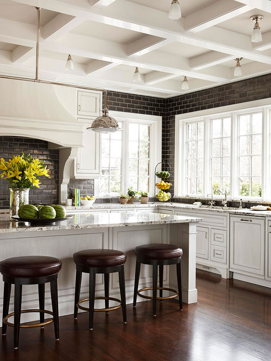 black subway tile backsplash in a black and white kitchen, coffered ceiling (BHG)