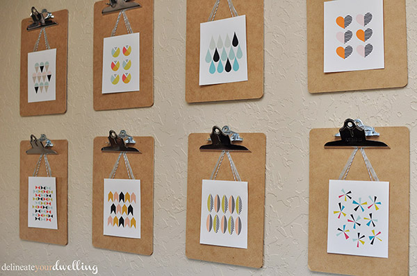 clipboard wall of mini art prints (Delineate Your Dwelling)