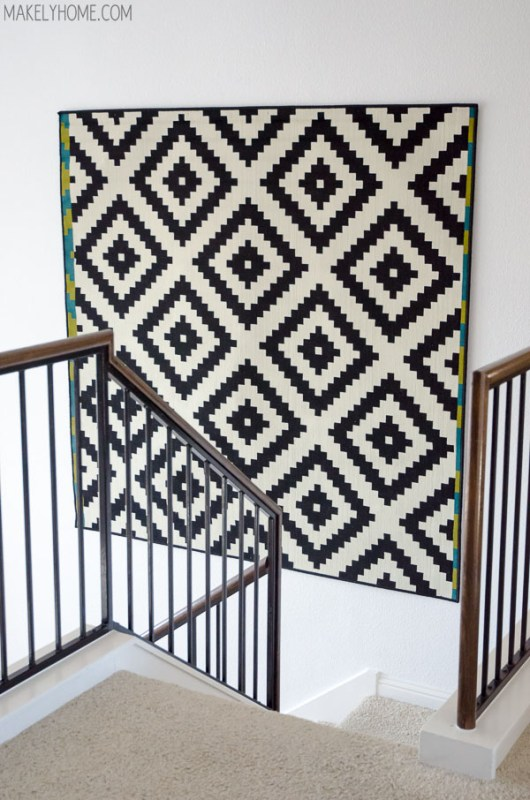 how to hang a rug on the wall for a large DIY wall art idea (Makely)