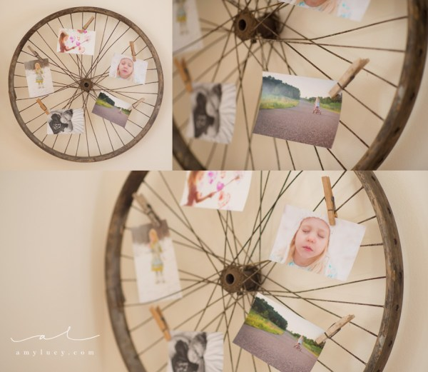 use an old bike wheel to display photos and art prints (Amy Lucy)