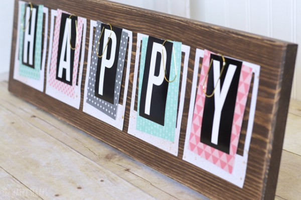 use oversized paper clips for a photo or art print display (The Happy Scraps)