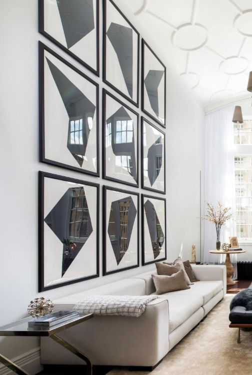 Hanging Paintings On A  Foot Wall