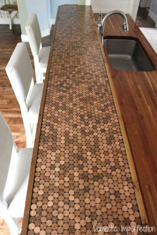 DIY penny countertop, with a durable epoxy sealant and a wood edge