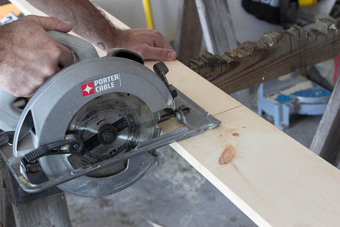 Sawing DIY Easy Craftsman Trim How to Steps featured on Remodelaholic.com