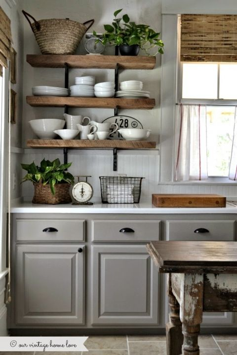 Farmhouse Kitchen Inspiration -- the combo of the wood shelves and natural bamboo shades with the white countertops and gray cabinets is perfect