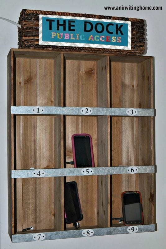 diy charging station mounted shelves by an inviting home featured on Remodelaholic
