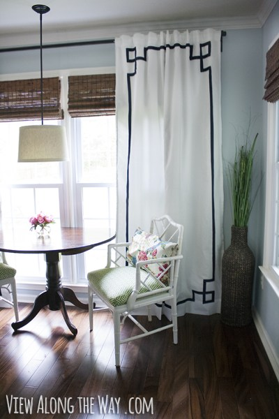 greek key panels with trim white curtains