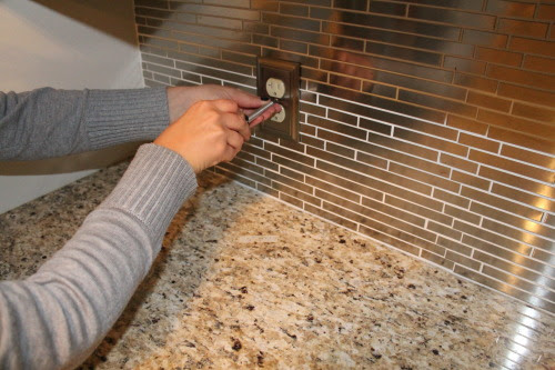 reinstalling switch plates over a stainless steel backsplash, construction2style on @Remodelaholic