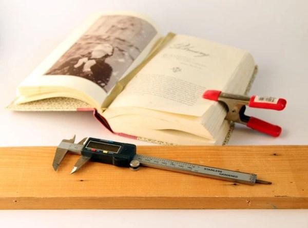turn old books into a wall shelf