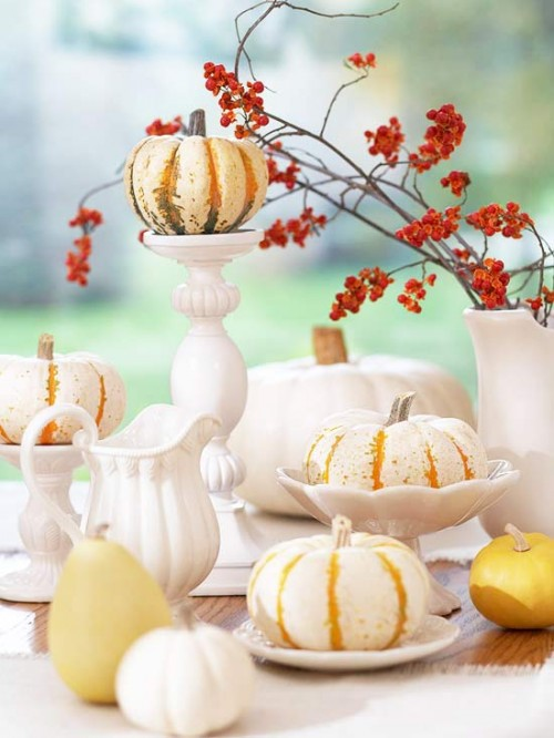 white dinnerware paired with small pumpkins and gourds Midwest Living