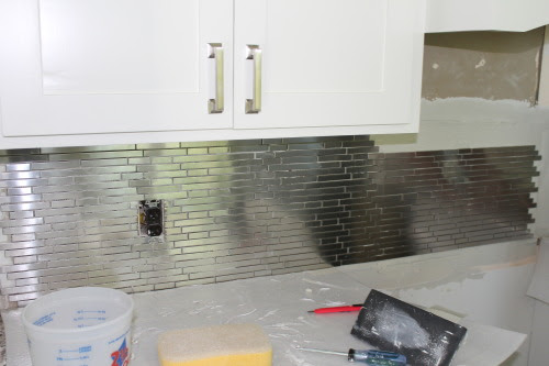 white kitchen remodel with stainless steel tile backsplash, construction2style on @Remodelaholic