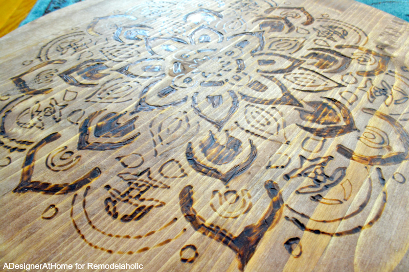 Use a stencil for a great wood-burned design on a planter stand!