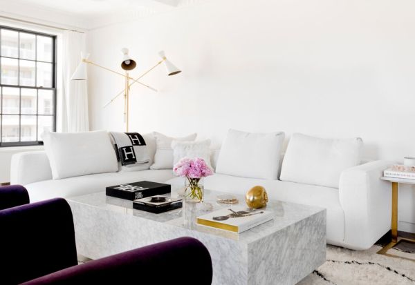 Lovely neutral black and white living room. Love the marble coffee table!