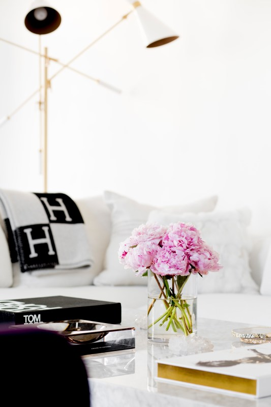Lovely neutral black and white living room (designed by Tamara Magel via @Remodelaholic)