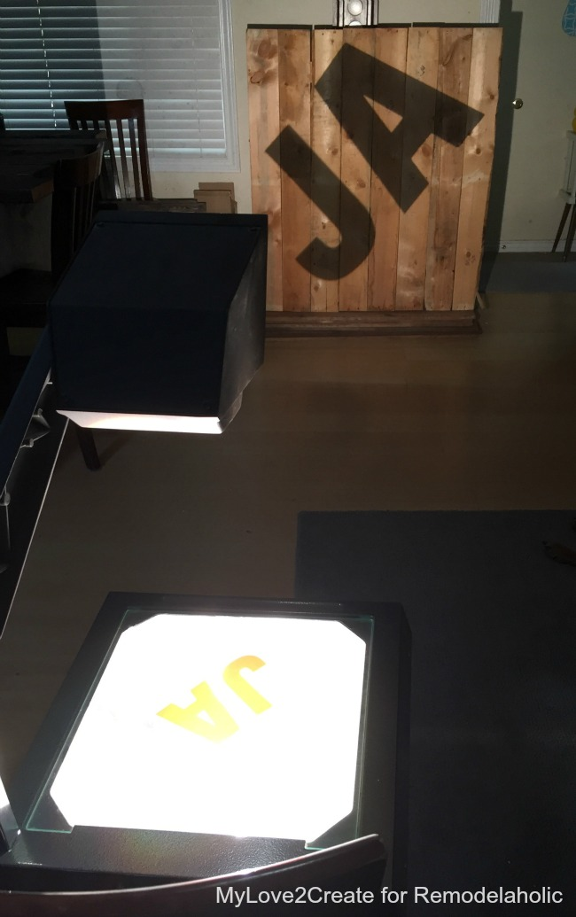 overhead projector to transfer letters on pallet wood for AMAZING rustic industrial letters