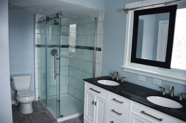 Bathroom Renovation with Sliding mirror over window, by Since I Became a Mom featured on @Remodelaholic
