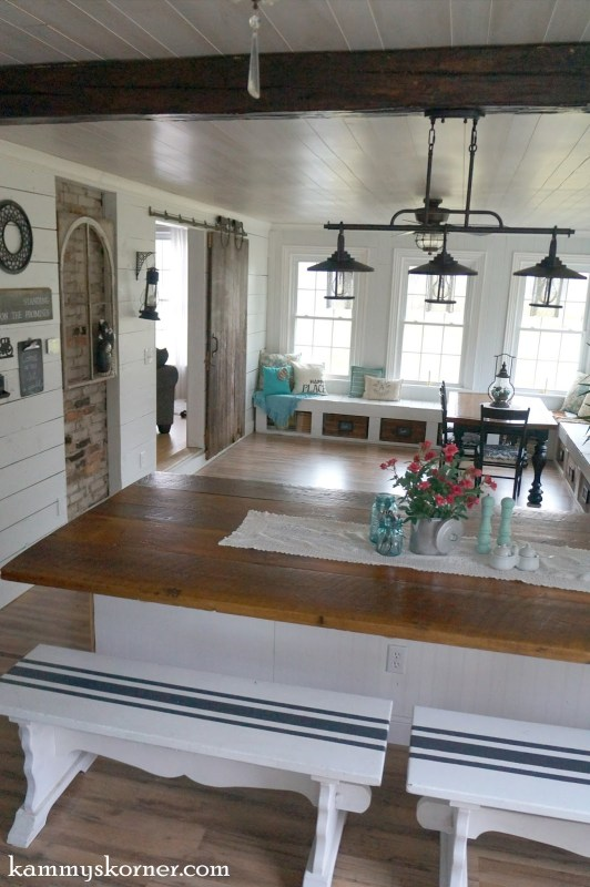 1 half wall dining table made from reclaimed wood, by Kammy's Korner featured on @Remodelaholic