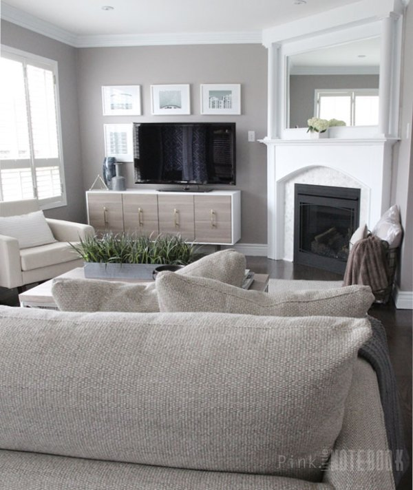Gorgeous neutral living room with a DIY fireplace makeover (and an easy way to DIY pillars!)