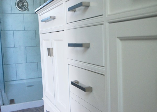 White vanity, simple hardware, bathroom remodel, by Since I Became a Mom featured on @Remodelohic