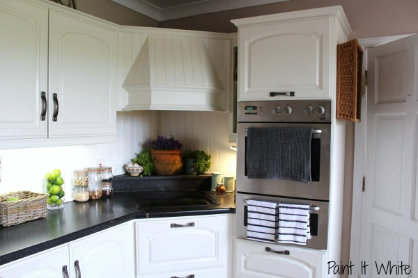 14 Annie Sloan chalk paint in Old White wood kitchen cabinet update, Rustic accents for white kitchen, by Paint it White featured on @Remodelaholic