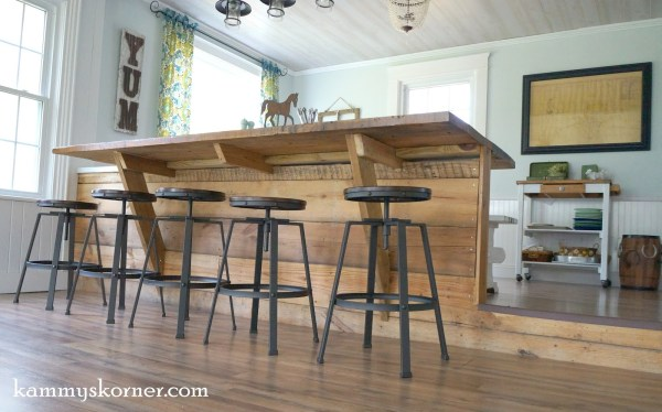20 Step-down sunroom, built-in breakfast bar made of reclaimed wood, by Kammy's Korner featured on @Remodelaholic