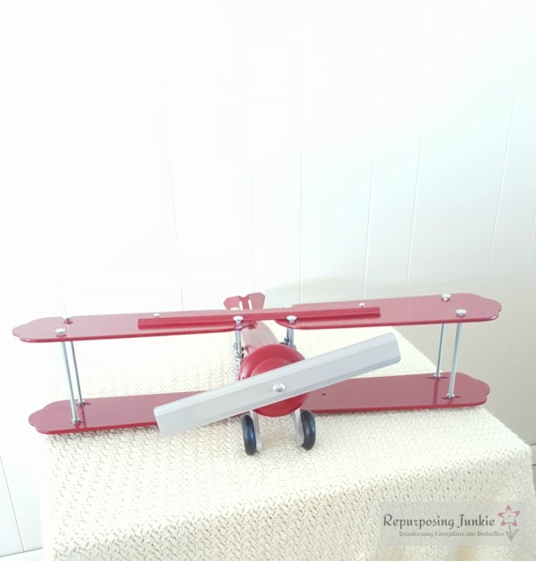 23 Build decorative airplane from repurposed ceiling fan blades, front view 7, by Repurposing Junkie featured on @Remodelaholic