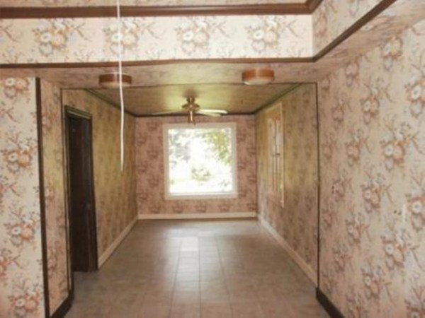 4 Dining room remodel using reclaimed wood, before, by Kammy's Korner featured on @Remodelaholic