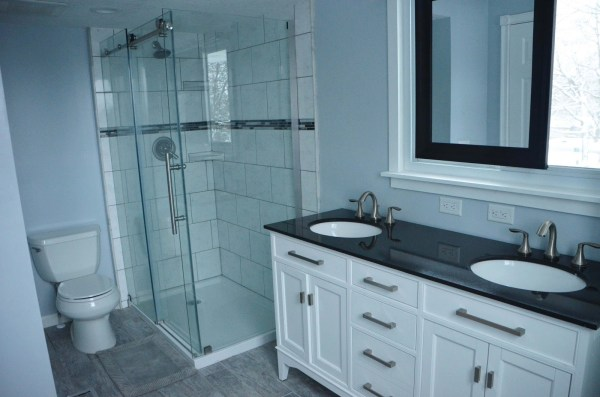 Master Bath Renovation, dark vanity countertop, sliding mirror, by Since I Became a Mom featured on @Remodelohic
