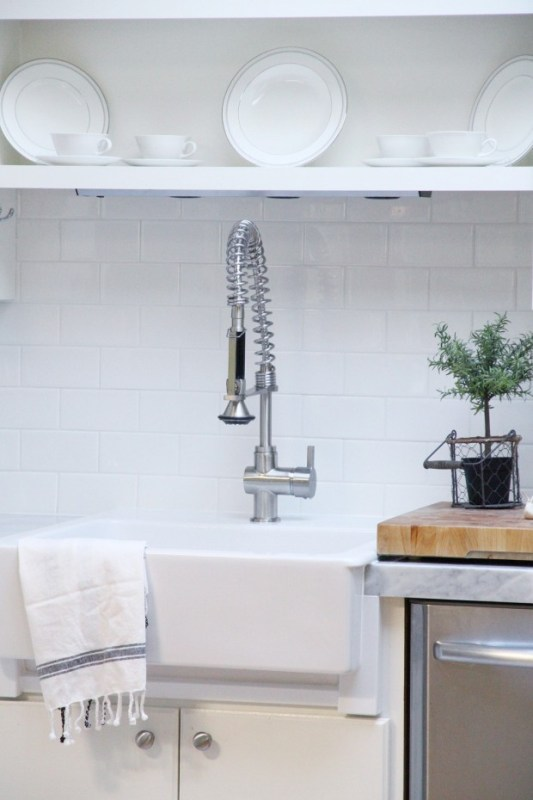 Kitchen makeover with subway tile backsplash and marble countertops -- without removing the old countertops OR the backsplash