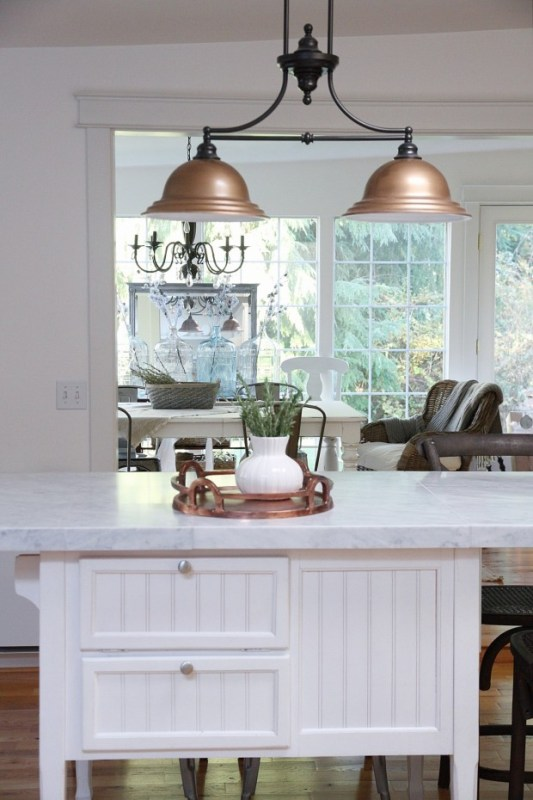 Perfection! Painted copper light fixture with DIY marble countertops