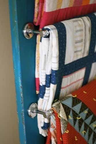 Smart! towel racks on a door with blankets