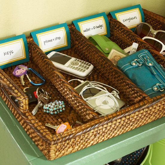 use a divided tray in an entryway drop zone to keep small things like phones, keys, and sunglasses organized, via IHeartOrganizing