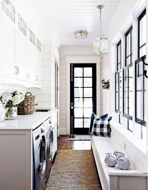 Monochrome Entry Inspiration -- I love the detail added to the cabinets over the washer and dryer.