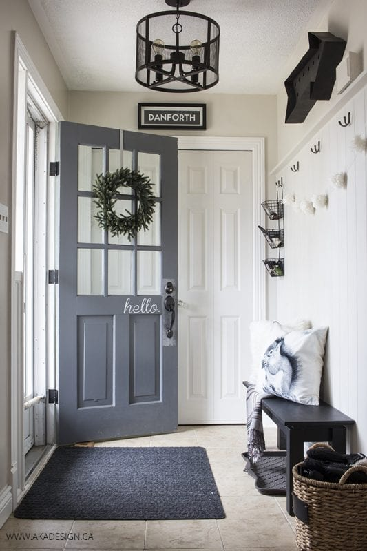 Neutral black and white entryway | 100+ Beautiful Mudrooms and Entryways at Remodelaholic.com