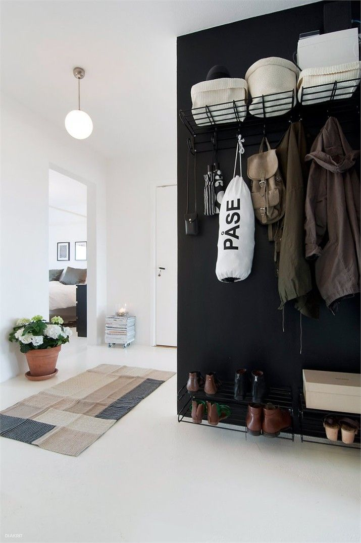 Monochrome Entry Inspiration: I like the black accent wall at the entry, it helps hide the black shelves rather than putting them on display.