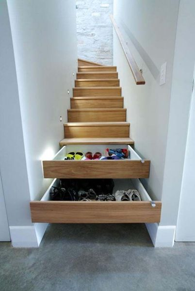 in the stairs shoe storage @ remodelaholic