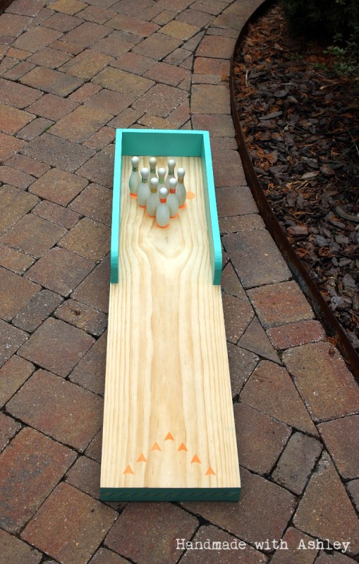 1 DIY kids bowling lane for indoor or outdoor play, Handmade by Ashley featured on @Remodelaholic