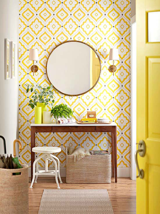 Yellow Entryway, love the wallpaper and all the neutral woven elements | 100+ Beautiful Mudrooms and Entryways at Remodelaholic.com