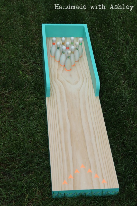 15 DIY bowling lane and pins made of scrap wood and finished with washi tape,