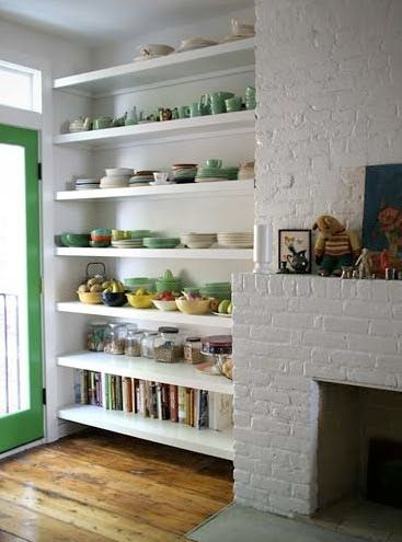 floating shelves around the fireplace
