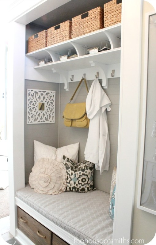 Closet made into Mudroom, love the profile of the shelves and the rope handled wood boxes below the bench | 100+ Beautiful Mudrooms and Entryways at Remodelaholic.com